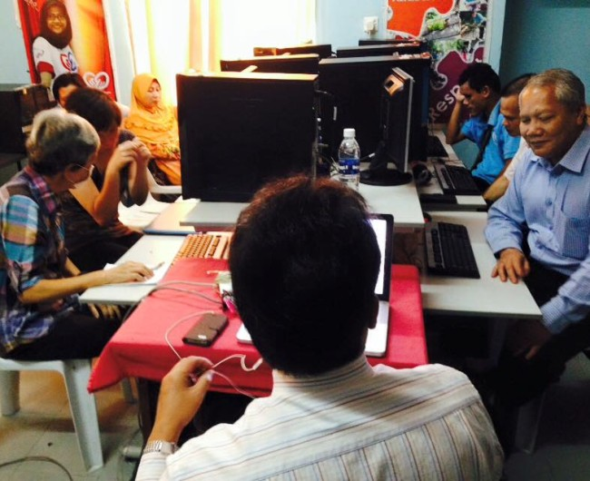 Six blind members from Sarawak Society for the Blind having ICT training