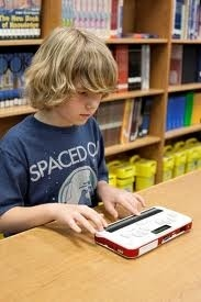 A boy using braille sense 2