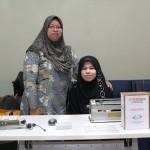 Elmiza with Low Vision Volunteer