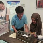 Learning how to type with braille machine